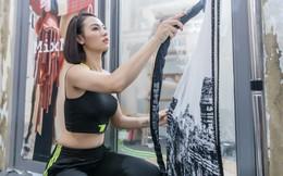 Hồng Quế tất bật giúp NTK Hà Duy ở hậu trường show thời trang tại Trung Quốc