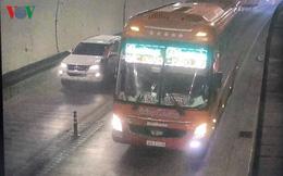 Tước giấy phép lái xe của tài xế xe khách vượt ẩu trong hầm Hải Vân