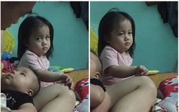 """Khuôn mặt hờn dỗi của bé gái khi bố mải bế em gây """"sốt"""" vì quá dễ thương"""