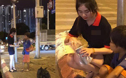 Dừng đèn đỏ tặng trà sữa cho cậu bé bán hàng rong, cô gái trẻ vừa được khen lại vừa bị chỉ trích