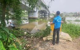 Thi thể người đàn ông đang phân huỷ nằm lẫn trong đám lục bình, trôi trên sông Sài Gòn