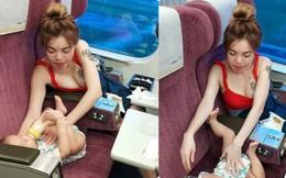 Thoải mái cho con uống sữa trên tàu, bà mẹ gây chú ý vì thân hình quá nóng bỏng