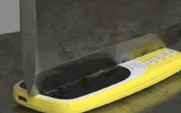"""Thử """"tra tấn"""" cắt đôi Nokia 3310 ngọt xớt bằng máy nén thủy lực nặng 100 tấn"""