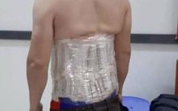 Người đàn ông dùng băng dính cuốn 58 chiếc đồng hồ quanh người bị bắt
