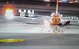 Máy bay chở 196 người bốc cháy khi vừa hạ cánh xuống sân bay