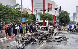 Tìm người nhà nạn nhân trong vụ xe Mercedes gây tai nạn rồi bốc cháy