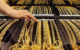 Giá vàng giảm mạnh trước áp lực của đồng USD