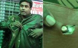 Nhân viên cảnh sát may mắn sống sót nhờ ví đựng tiền xu