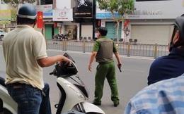 Công an bao vây đối tượng nghi mang lựu đạn vào ngân hàng ở Sài Gòn
