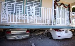 24h qua ảnh: Ô tô nằm bẹp dưới ngôi nhà bị sập