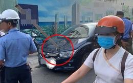 Đỗ dưới công trình đang thi công, ô tô bị thanh sắt rơi trúng, đâm thủng nắp capo