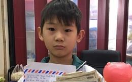Cậu bé 8 tuổi đập lợn tiết kiệm lấy 220.000 đồng đội mưa đi ủng hộ chống dịch Covid-19