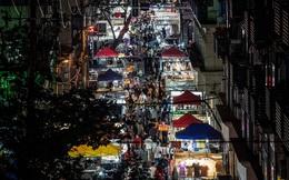 24h qua ảnh: Mọi người đi chợ đêm ở thành phố Vũ Hán
