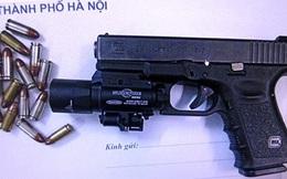 Khởi tố 2 đối tượng đi BMW mang theo súng