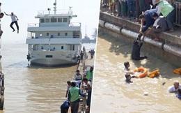 Hình ảnh ấn tượng khi vị thuyền trưởng 60 tuổi không ngần ngại nhảy xuống sông từ độ cao 12m để giải cứu người phụ nữ sắp chết đuối