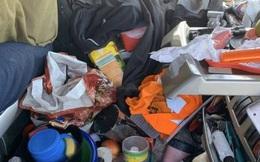 Tuýt còi xe tải vào kiểm tra, cảnh sát tá hỏa khi thấy đống rác ngập ngụa che hết cả tầm nhìn trong buồng lái
