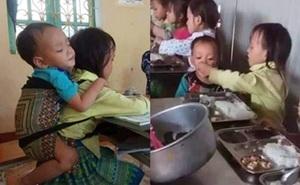 Bức ảnh chị 7 tuổi địu em 20 tháng tuổi đến lớp, chia nhau suất cơm trưa và câu chuyện phía sau