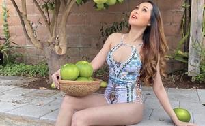 """""""Gái nhảy"""" Minh Thư gây tranh cãi khi mặc bikini ra vườn hái bưởi"""