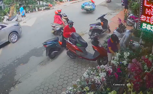 Clip: Pha trộm cắp tinh vi giữa phố Hà Nội của người phụ nữ áo đỏ, không một ai phát giác