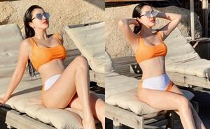 Bảo Thy khoe sắc vóc tuổi 33 với bikini màu cam
