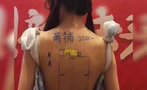 Trung Quốc: Vẽ sơ đồ nhà lên lưng trần của mẫu nữ để hút khách, công ty bất động sản gặp họa
