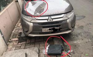 Vết lõm trên mui xe ô tô và bịch đen đáng ngờ ngay cạnh khiến nhiều người ngao ngán