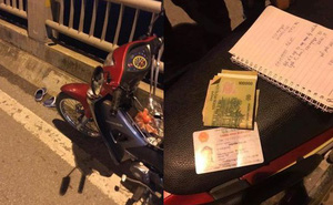 Cô gái để lại xe máy cùng giấy tờ tuỳ thân trên cầu Vĩnh Tuy rồi nhảy xuống sông Hồng