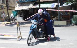 Lạ lẫm phố Trần Hưng Đạo được rào chắn, ngơ ngác chui dây tìm lối thoát