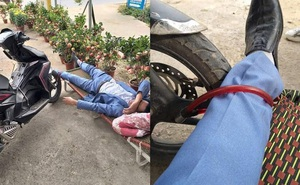 Say không biết gì, người đàn ông nằm vật giữa cửa hàng cây cảnh, khóa bánh xe vào chân