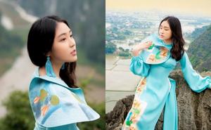 Mẫu nhí Vũ Trần Bảo Nguyên diện áo dài, khoe sắc trên đỉnh Hang Múa