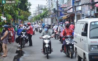 TP.HCM: Dân thong dong tập thể dục, đi chợ, quán ăn nhộn nhịp trong ngày đầu quận 7 mở cửa trở lại