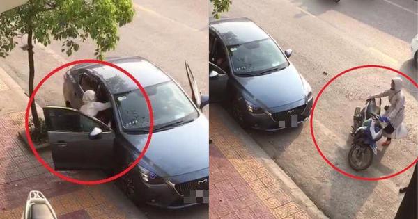 Clip: Người phụ nữ chùm kín mít, chặn đầu ô tô rồi đánh tới tấp người ngồi trong xe