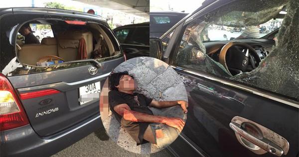 Hà Nội: Xế hộp bị người đàn ông thần kinh cầm gạch lao vào đập phá