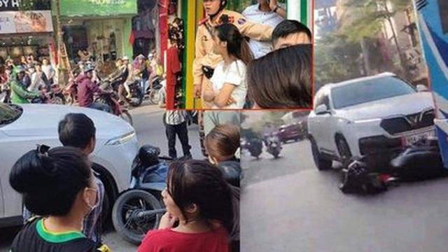 Ô tô SUV kéo lê xe máy SH trên phố Khâm Thiên