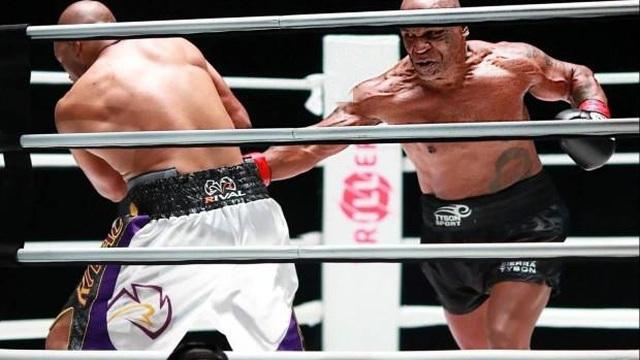 """Báo Trung Quốc chê Mike Tyson """"diễn kịch"""" trên võ đài, đòi một trận quyết đấu với Yi Long"""