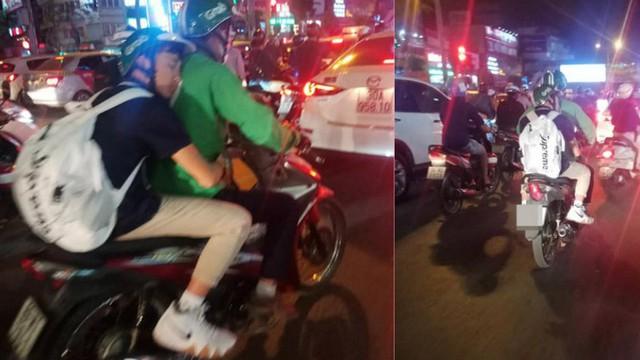 Thanh niên ngủ trên lưng nam tài xế Grab Bike khiến bao người đi đường tò mò, chụp ảnh