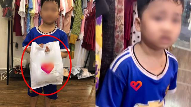 Cậu bé xách túi đồ ra khỏi shop quần áo bị bố vụt túi bụi, câu chuyện đằng sau mới gây bất ngờ