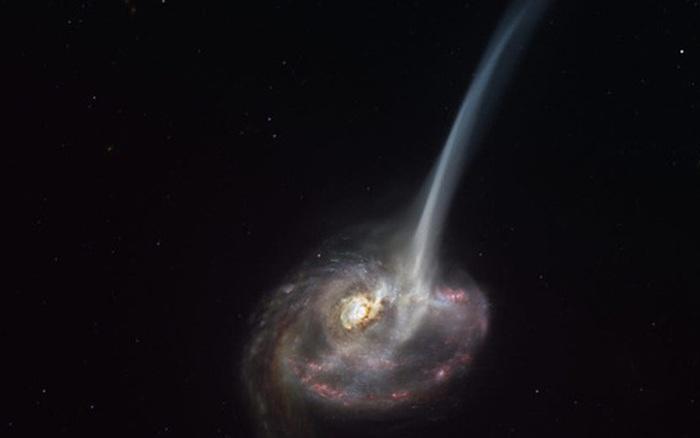 Thiên hà 'có đuôi' này đang chết, mỗi năm rò rỉ ra không gian lượng vật chất tương đương 10.000 ngôi sao